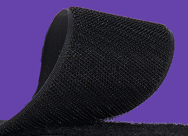 A roll of black VELCRO hook and loop